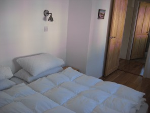 Downstairs bedroom with two single beds