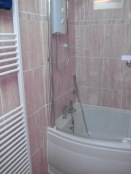 Upstairs bathroom with electric shower over the bath