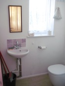 Utility room with washing machine, boiler and wc