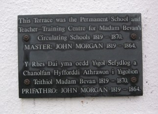 Plaque attached to a row of houses in College Square, Newport, Pembs.